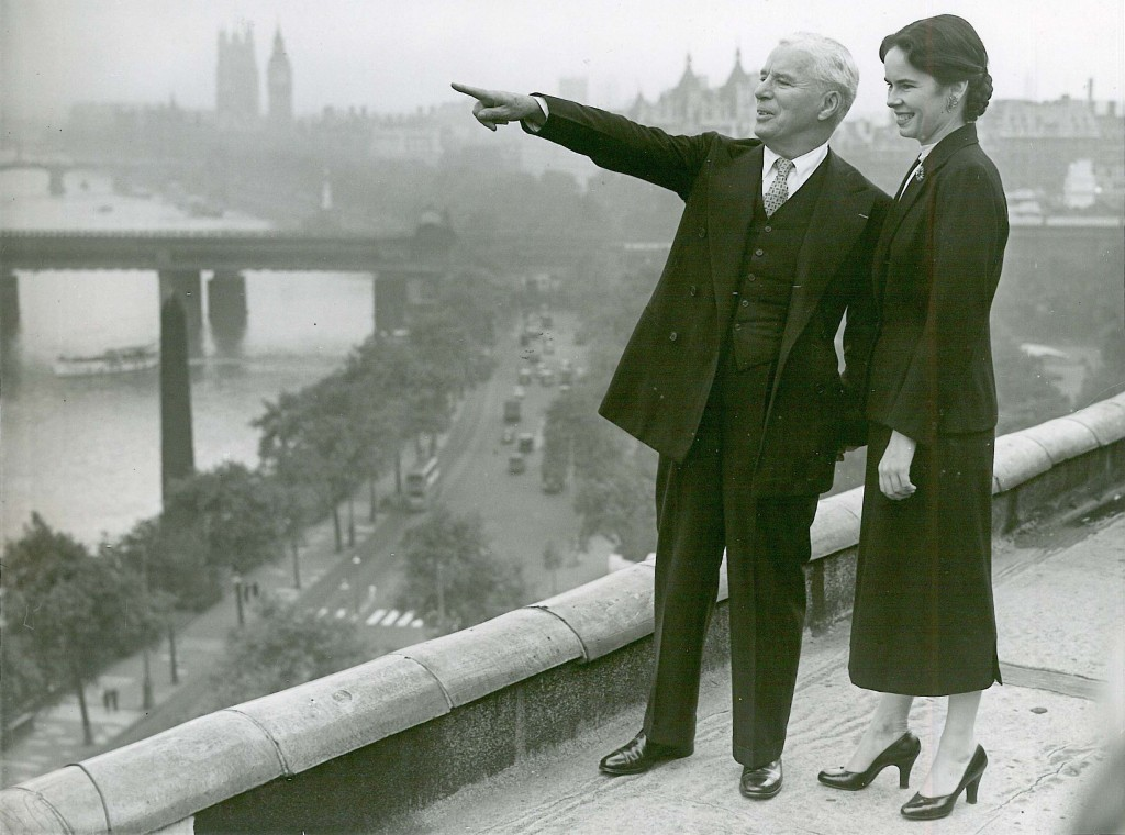 Charlie Chaplin and wife Oona on the roof